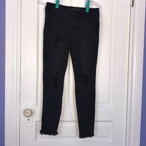 Light washed black American Eagle jeans.